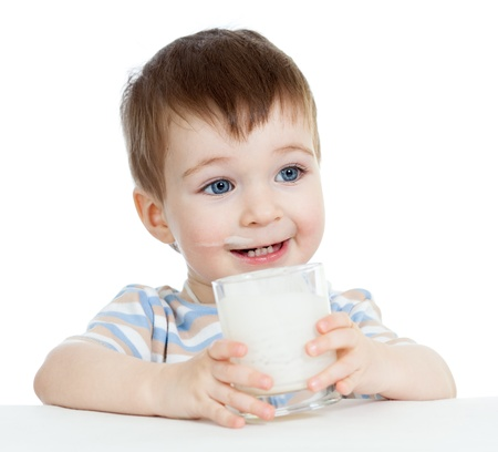 drinking milk: baby boy drinking yoghurt or kefir isolated on white