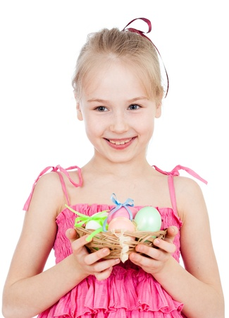 cute smiling kid girl holding Easter eggs in basket photo
