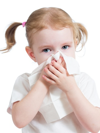 sneeze: kid cleaning nose with tissue isolated on white Stock Photo
