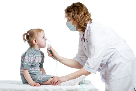 Doctor holding inhaler mask for kid breathing, hospital photo