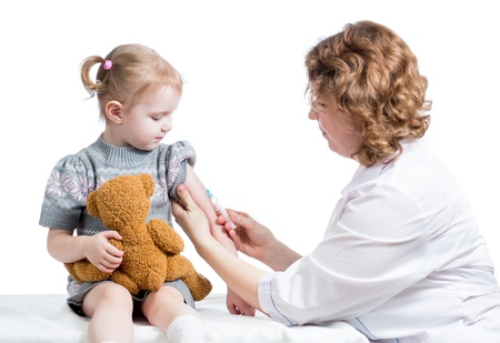 vaccinating: doctor vaccinating kid isolated on a w Stock Photo