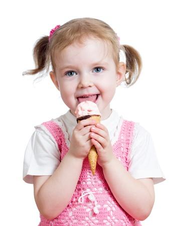 child ice cream: happy kid girl eating ice cream in studio isolated