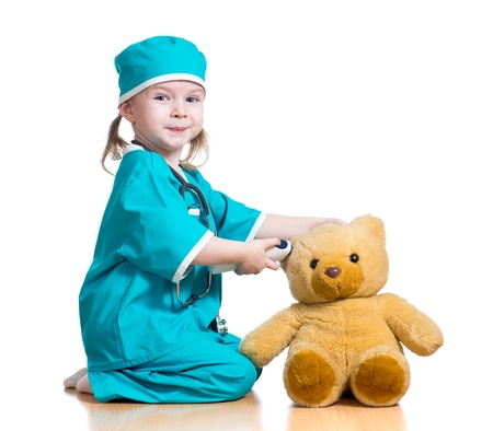 pediatrics: doctor girl playing and measuring  temperature toy isolated on white