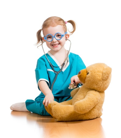 doctor s smock: Adorable child with clothes of doctor over white Stock Photo