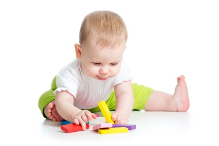 baby girl playing with colorful toys, isolated on white background photo
