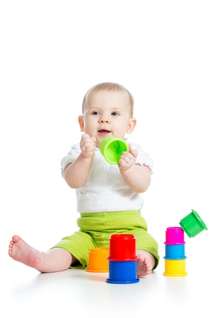 Funny little child playing with toys isolated over white photo