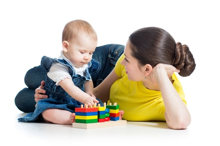 mother and baby playing with building blocks toy isolated on white photo