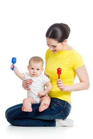 playing instrument: Happy mother and baby girl having fun with musical toy isolated on white Stock Photo