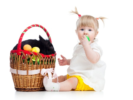 funny baby girl with Easter bunny in basket photo