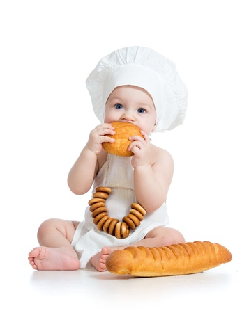 Little baby boy eating bread photo