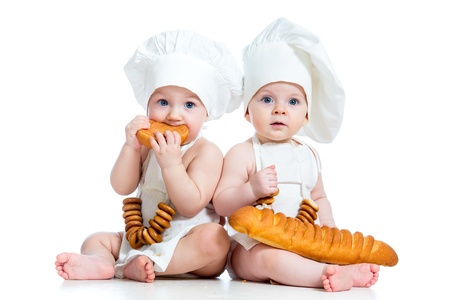 9 months: Little bakers kids boy and girl Stock Photo