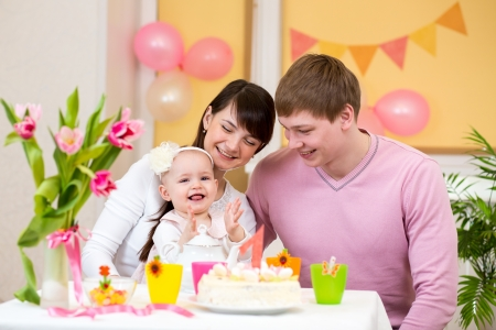 family celebrating first birthday of baby daughter Stock Photo - 18356213