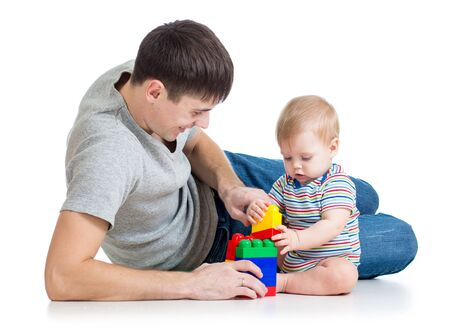 happy father playing with baby boy photo