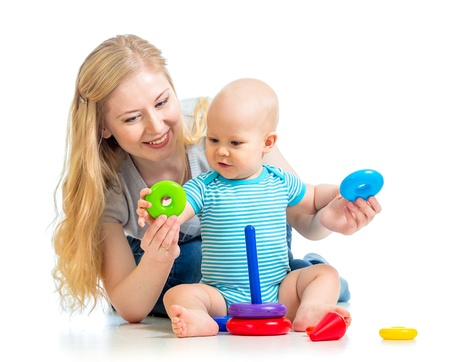 baby boy and mother playing together Stock Photo