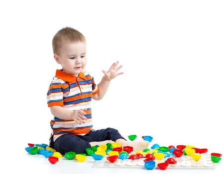 Adorable little boy playing mosaic toy Stock Photo - 18498451