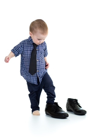 fashion shoes: little boy trying on father shoes
