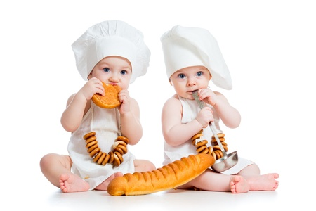 6 9 months: Little bakers kids boy and girl Stock Photo