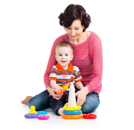 baby boy and mother play together photo