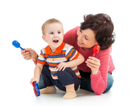 tambourine: Mother and baby boy having fun with musical toys  Isolated on white background
