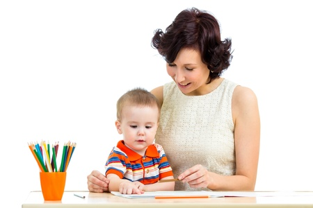 baby boy and mother drawing with colorful pencils photo