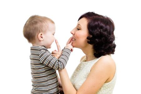 joyful mother playing with her kid boy Stock Photo - 18571591