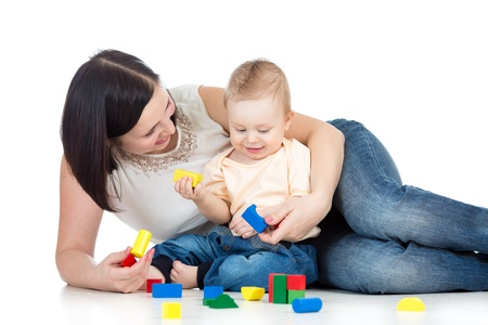 baby boy and mother playing together with construction set toy Stock Photo - 18571559
