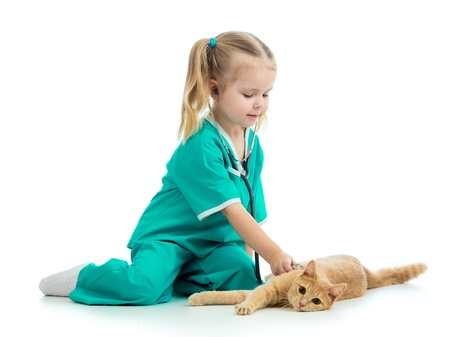 Cute kid girl playing doctor with cat isolated photo