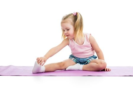 stretches: Kid doing fitness exercises Stock Photo