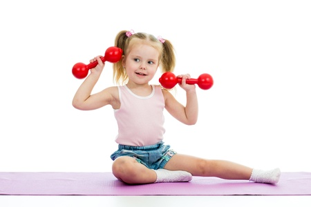 gymnastics girl: Kid doing exercises with dumbbells Stock Photo
