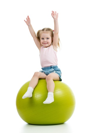 Kid having fun with  gymnastic ball isolated photo