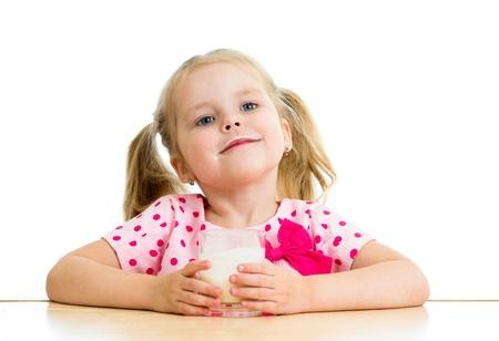 kid drinking yogurt or kefir over white photo