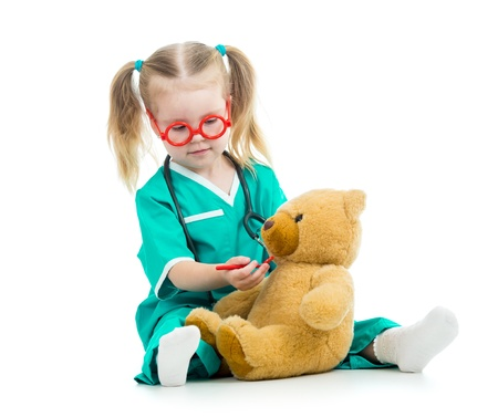 doctor s smock: child girl dressed as doctor playing with toy Stock Photo
