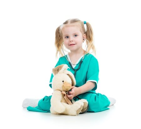 kid playing doctor and examining toy Stock Photo - 18766199