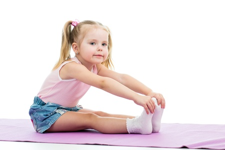 gymnast: Child girl doing fitness exercises Stock Photo