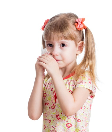 kid cleaning nose with tissue isolated on white photo