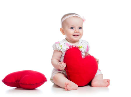 the infancy: baby girl with pillow in heart shape