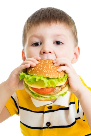 Kid boy eating delicious hamburger photo