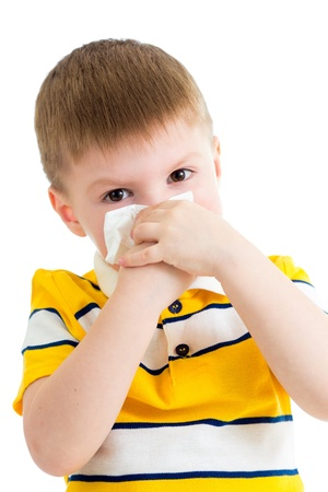 sniffle: kid cleaning nose with tissue isolated on white Stock Photo