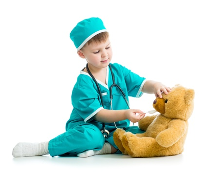kid doctor: boy kid playing doctor with toy