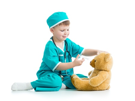 doctor s smock: boy kid playing doctor with toy