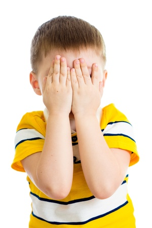 hiding face: Kid crying or playing  with hiding face isolated