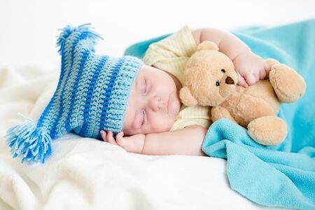 quiet baby: sleeping baby boy with toy