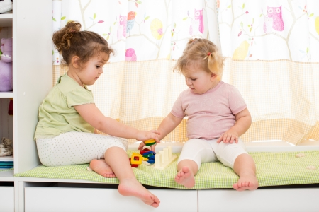two kids sisters play together indoors Stock Photo - 18963473