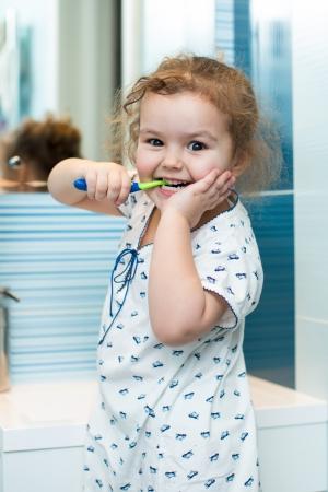 Child girl brushing teeth in bathroom Stock Photo - 18963464