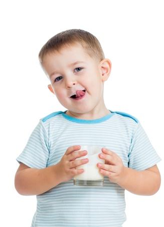kid boy drinking yogurt or kefir isolated photo