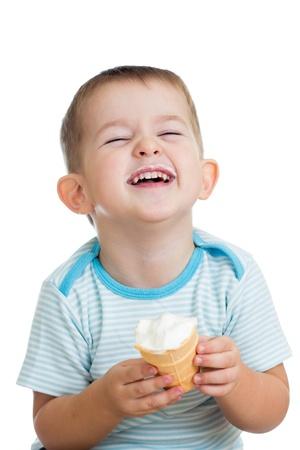 child ice cream: happy kid boy eating ice cream in studio isolated Stock Photo
