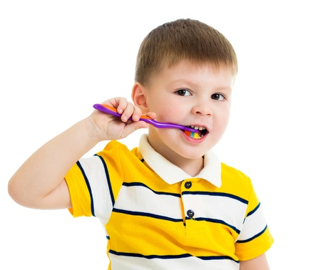 boy kid cleaning teeth isolated photo
