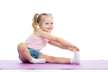 Little girl doing fitness exercises photo