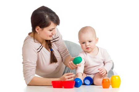 baby girl and mother playing together with colorful toys Stock Photo - 19114501