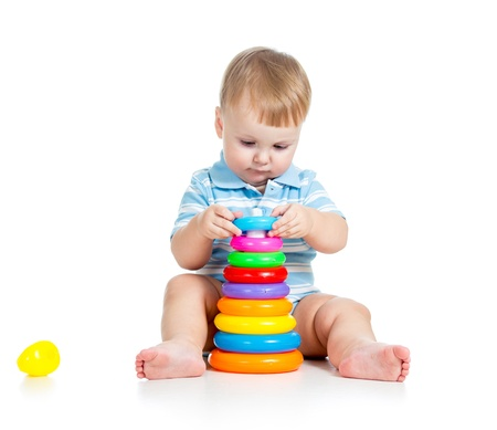 baby boy playing with colorful toy photo